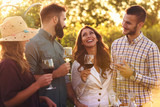 Happy friends having fun drinking wine at winery vineyard - Friendship concept with young people enjoying harvest time together - 225581787