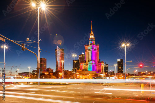 The Palace of Culture and Science and night traffic during rush hour. - 225588960