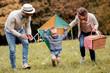 Leinwandbild Motiv Happy family having fun in the park