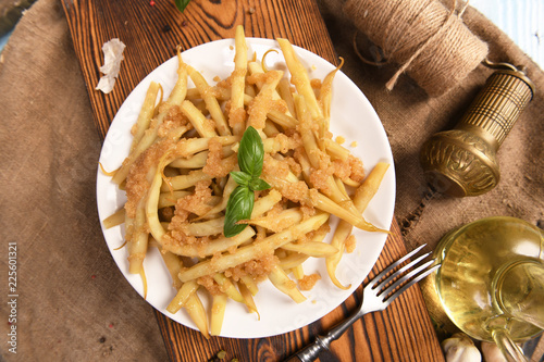 Foto Murales Yellow beans with butter and breadcrumbs