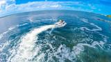 Man on a waverunner on the caribbean sea - 225602338
