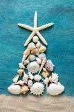 Christmas tree made from sea shells and starfish on wooden blue background, top view - 225611167