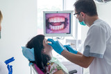 The dentist examines the patient with camera