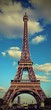 Eiffel Tower and the blue sky with vintage effect