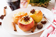 Stuffed baked apples with cottage cheese, raisins and almonds for Christmas on a white background. Xmas food dessert.