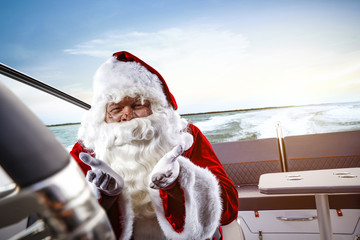 Santa Claus on boat and free space for your decoration.