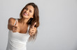 Leinwandbild Motiv girl enjoys success and shows a gesture of luck