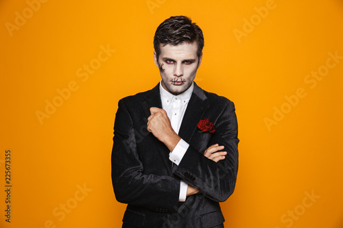 Handsome man zombie looking camera seriously isolated