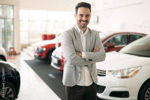 Portrait of happy customer buying new car © nd3000