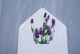 Scrambled aromatic lavender put in a white envelope for letters. Top view