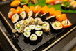 Assortment of tasty and delicious Sushi. Most popular Japanese food. Maki Sushi is vinegared rice and raw fish or seafood wrapped in seaweed. Healthy eating and eat well concept.