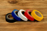 Rolls of colored duct tape on wooden table - 225707578