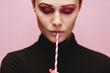 Leinwandbild Motiv Beautiful female model with a straw