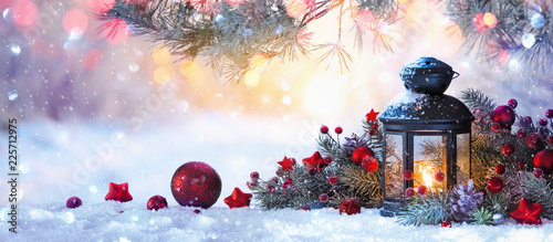 Christmas Lantern On Snow With Fir Branch in the Sunlight. Winter Decoration Background - 225712975
