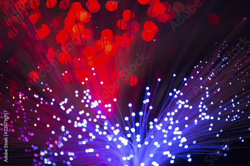 Kaleidoscopic, colorful multi-colored fiber optic lights on a black background. - 225716957