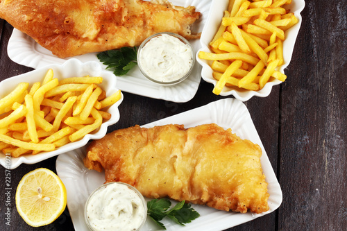 traditional British fish and chips consisting of fried fish, potato chips and mayonnaise - 225740921