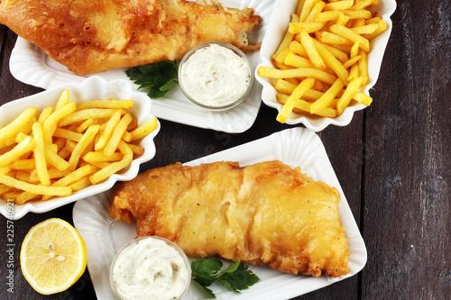 Leinwanddruck Bild traditional British fish and chips consisting of fried fish, potato chips and mayonnaise