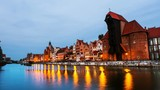 Gdansk, Poland. A sunset time-lapse on  a cloudy summer morning in the old town of Gdansk, Poland, with boats moored to the enbankment and Brama Żuraw. - 225741914
