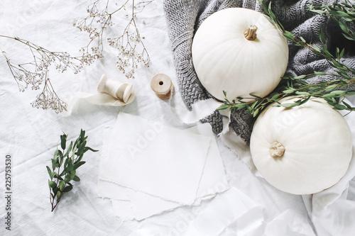 Leinwanddruck Bild Autumn styled photo. Feminine wedding desktop stationery mockup scene with blank greeting card, eucalyptus, ribbons, white pumpkins and gypsophila flowers. Table background. Thanksgiving. Flat lay.
