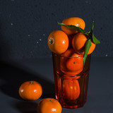 Tangerines on a black background
