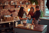Mom dad and little daughter together cooking breakfast in loft style kitchen. - 225758793