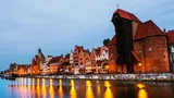 Gdansk, Poland. A sunset time-lapse on  a cloudy summer morning in the old town of Gdansk, Poland, with boats moored to the enbankment and Brama Żuraw. Zoom in - 225763142
