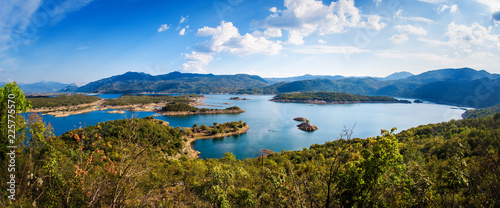 Panoramic view of summer mountain range with clear mountain lake © guruXOX