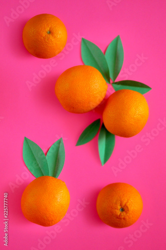 photo Oranges on a saturated pink background. use for postcards, cards, wedding, wallpapers, textiles, scrapbooking, decoration, invitations, background, holiday. - 225777740