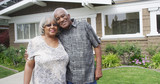 Retired African couple embracing each other on yard - 225777959