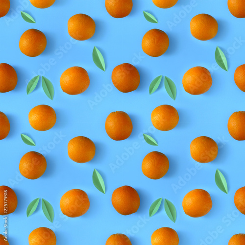 photo Oranges on a saturated blue background. use for postcards, cards, wedding, wallpapers, textiles, scrapbooking, decoration, invitations, background, holiday. - 225779316