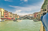 First person view from vaparetto public transport of the Grand Canal and Rialto Bridge in Venice, Italy