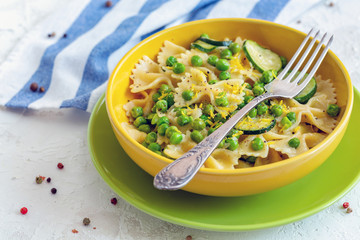 Traditional Farfalle pasta with zucchini and green peas.