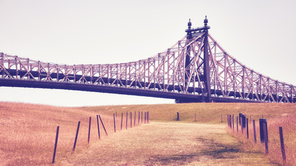 Vintage stylized picture of the Queensboro Bridge seen from Roosevelt Island, New York City, USA.