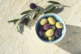 Olives and olive branch on a light natural stone background. Mediterranean still life, flat lay - 225821387
