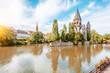 Leinwanddruck Bild - Riverside with basilica in Metz, France