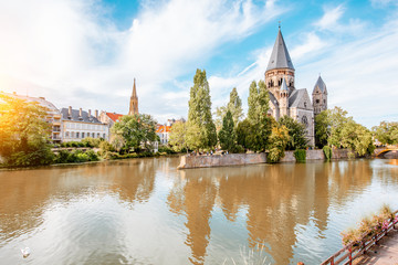 Riverside with basilica in Metz, France