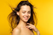 Quadro female beauty wellness and health concept. girl with radiant smooth skin and long shiny hair. portrait of young woman on yellow background.