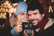 Leinwandbild Motiv couple hot wine christmas market