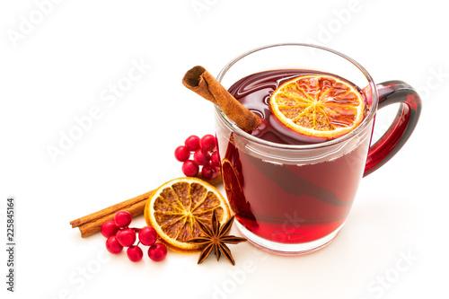 Leinwanddruck Bild Hot red mulled wine isolated on white background with christmas spices, orange slice, anise and cinnamon sticks