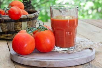 Glass of Tomato Juice and Fresh Tomatoes