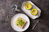 Healthy food for diet as bread fruit and vegetables with egg baked in avocado - 225861518