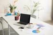 Leinwandbild Motiv Photo of laptop and white cup of coffee on desk in modern office