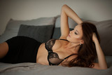 Boudoire photo of a gorgeus young woman lying in bed - 225867947