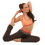 Young attractive smiling woman practicing yoga, sitting in One Legged King Pigeon exercise, Eka Pada Rajakapotasana pose, working out,
