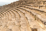 Closeup photo of steps of Roman amphitheatre in the ruins of Hierapolis, in Pamukkale, Turkey.