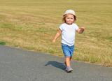 Little girl running on meadows. - 225917738