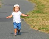 Little girl running on meadows. - 225917744