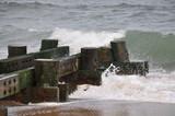 Beach Pier with Waves Crashing