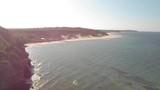Aerial drone shot flying along the Australian coastline towards a beach, in Cape york, Queensland, Australia - 225921708