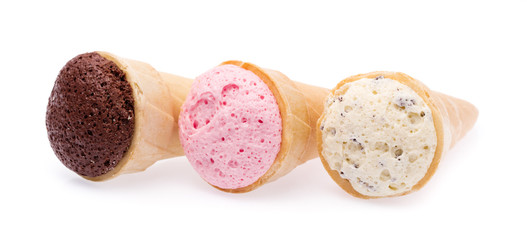 Chocolate, vanilla and strawberry Ice cream in the cone isolated on white background